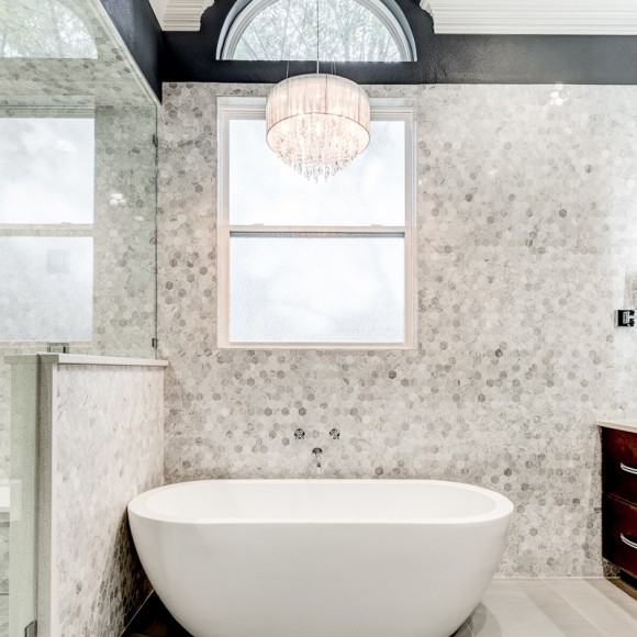 Pampering bathroom remodel includes a steam shower and D-TV control panel contemporary bathroom with marble hexagon tiles