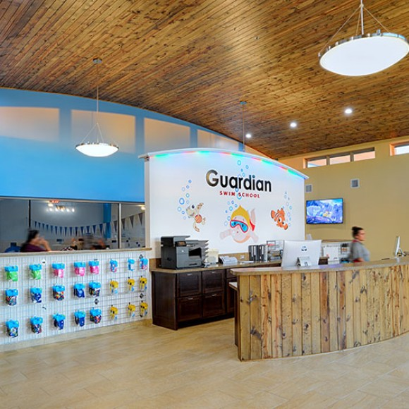 Architectural photography by Blue Logic Productions.  A view of the front desk of the Guardian Swim facility designed by Khan Architects. Architectural photography, Khan Architects, Guardian Swim