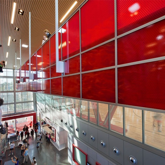 This LEED Gold Student Recreation Center at California State University, Northridge, is a three story 123,000-square-foot facility funded entirely by student fees. The facility includes a three-court gymnasium, a multi-activity court, a 46-foot-high rock-climbing wall, running track, racquetball courts, weight and fitness areas, and several multi-purpose studios for aerobics, martial arts and dance. Additionally, the project includes a recreational aquatics area and a 130,000-square-foot illuminated synthetic turf field for outdoor recreational activities. CSU Northridge Student Recreation Center