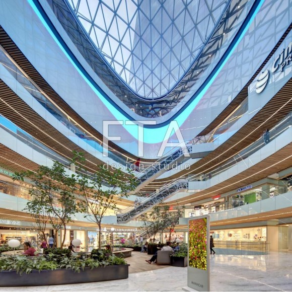 Centro Comercial Manacar Mexico City, Mexico Open 2017  Centro Comercial Manacar is located at the base of an iconic office tower shaping one of the corners of a busy intersection in Mexico City. The commercial plinth is organized around an egg-shaped atrium, a space equally distinct and memorable as the iconic form of the office tower. The shopping, dining and entertainment venue creates synergy with the office tower and provides convenient services at a major urban node.  The location on the transit corridor of Avenida Insurgentes, one of the main thoroughfares in the city, positions the commercial facility in line with the vision of Mexico City's sustainable growth.