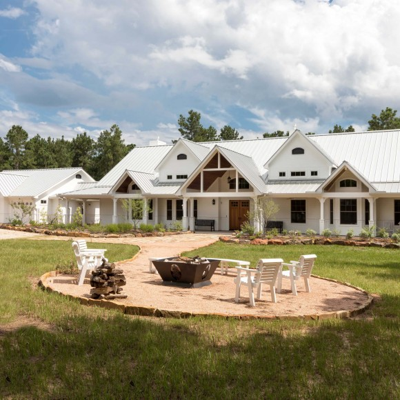 Peponi Pine Lodge is a 4,000 square foot, 1 story residence with 6 car garage, located out in the piney woods of east Texas. The key to the design was to maximizing the natural light into the heart of the interior, as well as frame the beautiful views of the surrounding forest. Photographer: Jerry B. Smith