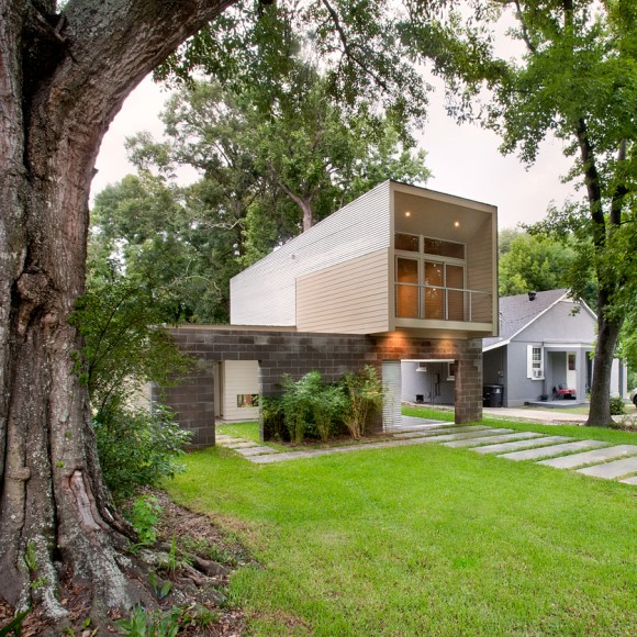 Scissor House: The design capitalizes on the site's mature trees to provide ample shade and filtered sunlight. This enhances the owner's ability to find a comfortable, outdoor space at almost any time of the day during every season of the year. Leveraging the outdoor spaces allows this small, modest house to live big.