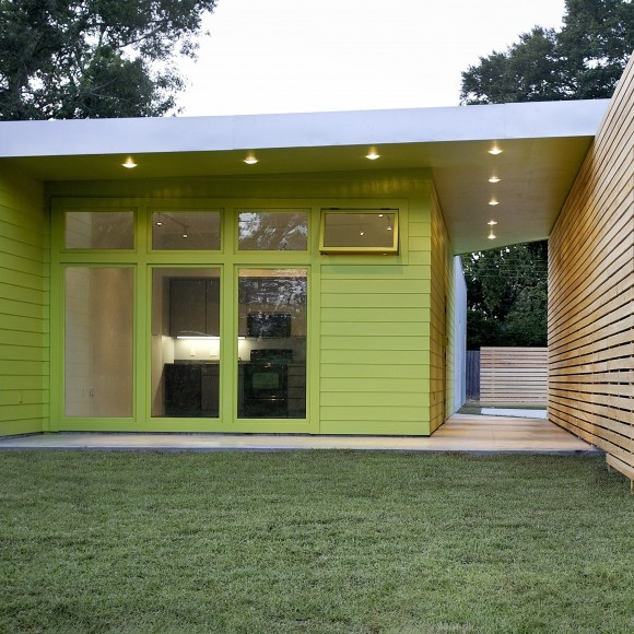Kiwi House: The porch and screen wall were configured to provide the owners with the privacy and security they needed while, at the same time, maintaining an openness to the street and connection with their neighbors.