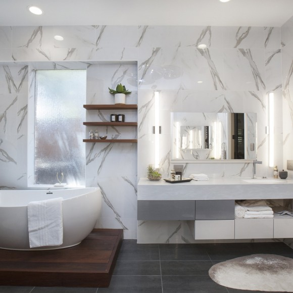 Award-winning bathroom remodel. Luxurious bathroom renovation with Italian vanities, modern teardrop light fixture, and freestanding tub contemporary spa bathroom remodel