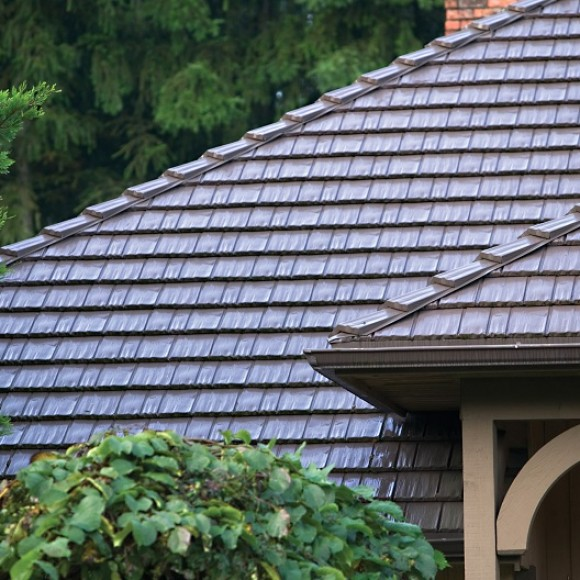 Rustic Shingle allows you to enjoy the beautiful aesthetics as unique as your home without compromising the integrity of your roof. Rustic Shingle's combination of distinctive looks and indisputable benefits creates a roof system that will protect your home from all of life's challenges – whether a severe windstorm or rising energy costs.
