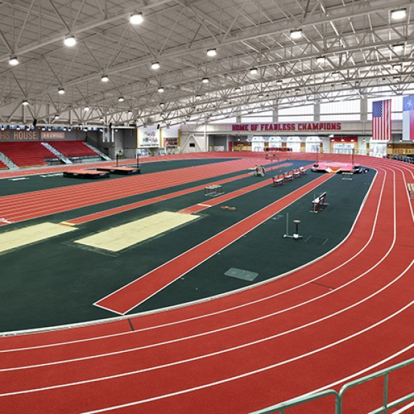 The Texas Tech University Sports Performance Center contains a world-class, 200-meter, banked track and an artificial turf field for use by the football team and other Texas Tech student athletes. The stadium renovation razed the existing south end zone building, which previously houses administrative offices for Athletics, and rebuilds with new suites and related premium spaces, team training table, and new large format video boards. Dror Baldinger