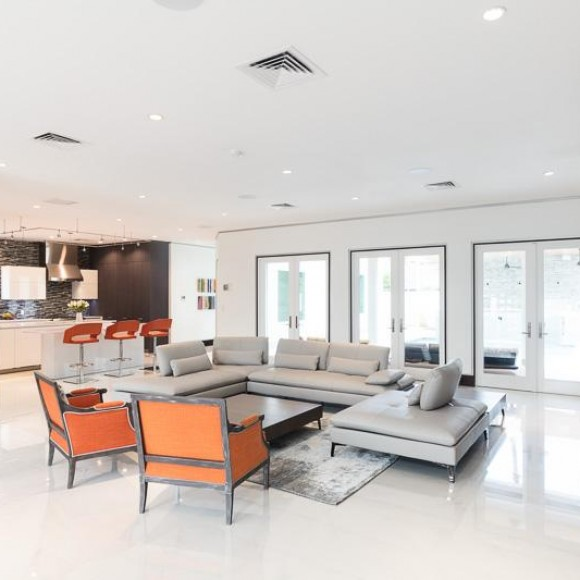 It is the transformation of a 2003 post-modern style residence, into an updated modern/contemporary home.  The homeowners did not want to tear it down and start over, so it was up to us to bring it up to date.  This house was featured on the 2017 Houston Modern Home tour!
